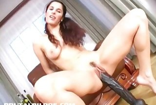 Slim brunette Demia gapes her pussy with a brutal dildo