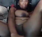 Black milf on phone and dildo in ass plays with pussy